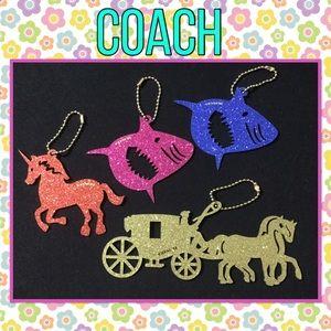 Four Coach bag tags